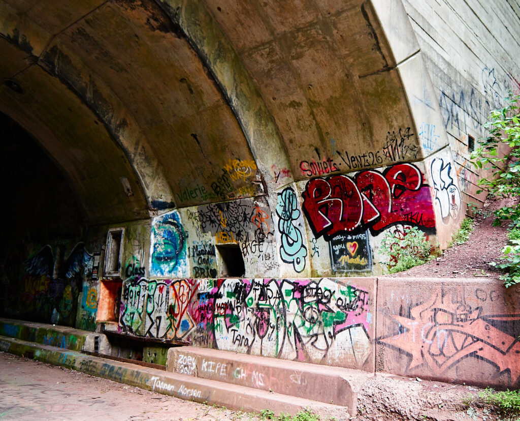 graffiti on the right side of the tunnel entrance