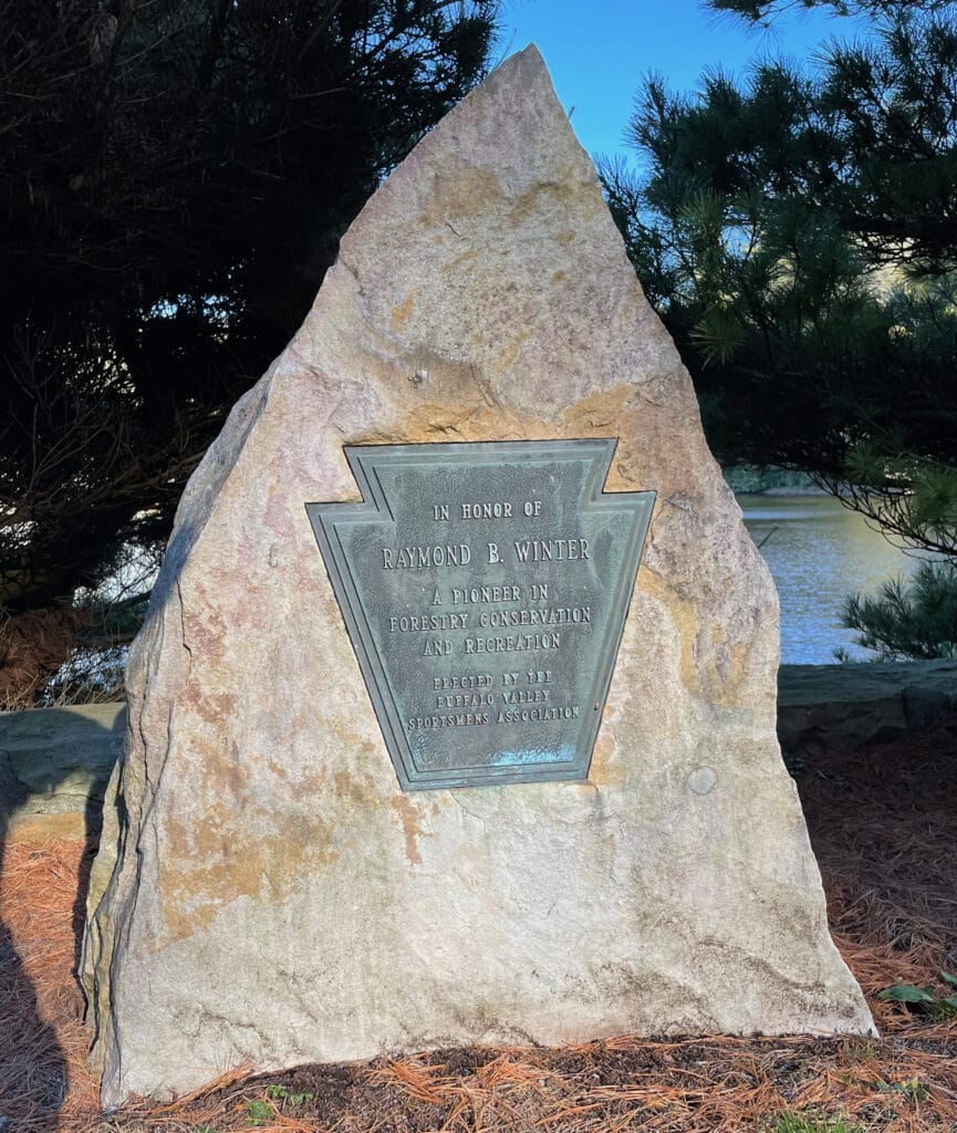 Photo of the In Honor Of plaque in the parking are of the park.